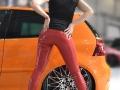 fetish model in red latex pants on public action called international prague car festival