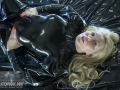 chained-in-chains-in-loose-latex-catsuit-08