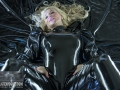 chained-in-chains-in-loose-latex-catsuit-12