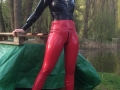 sexy latex model at czech fetish action wearing red latex jeggings + latex jacket with hood