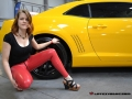 fetish model in red latex pants on public action called international prague car festival