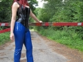 redhead in latex pants walking on public road in high heels