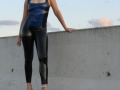 redhead on public construction site wearing rubber tight leggings and latex top plus high heels