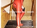 redhead rubber agent in sexy tight latex catsuit and high heels