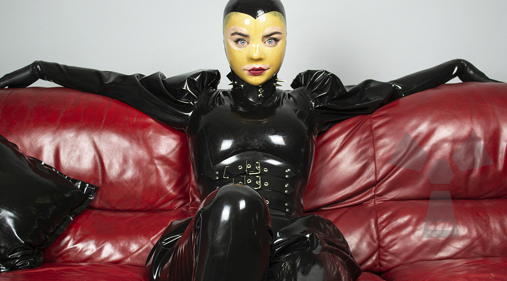 latex-model-in-loose-black-latex-catsuit-vega-1